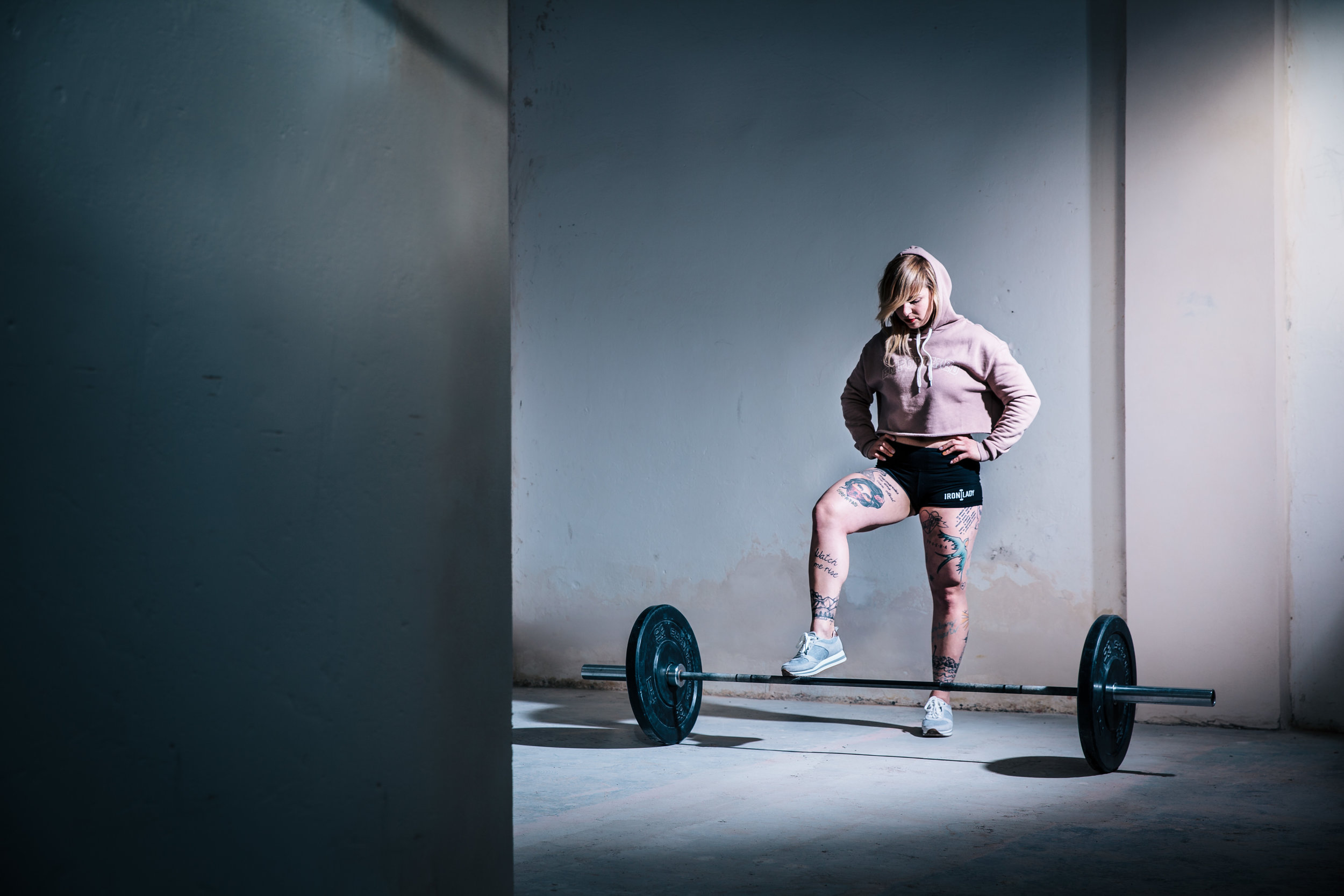 girl and barbell