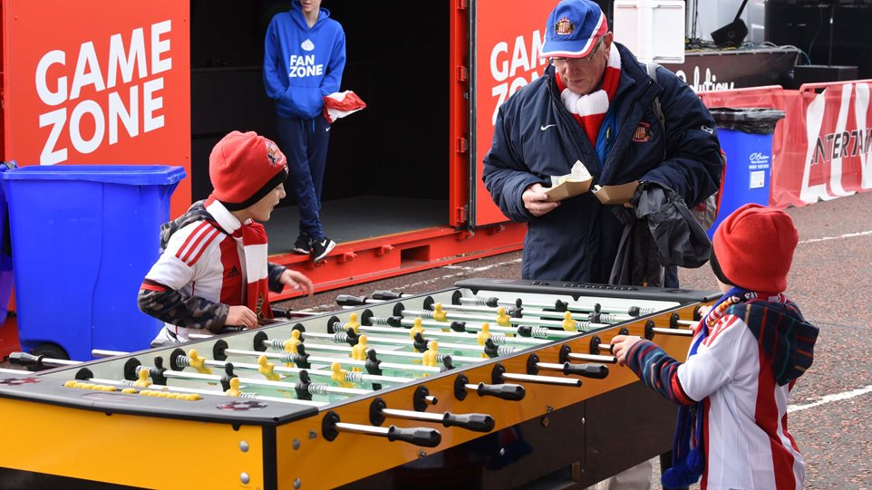 Two young fans go head to head at table football.jpg