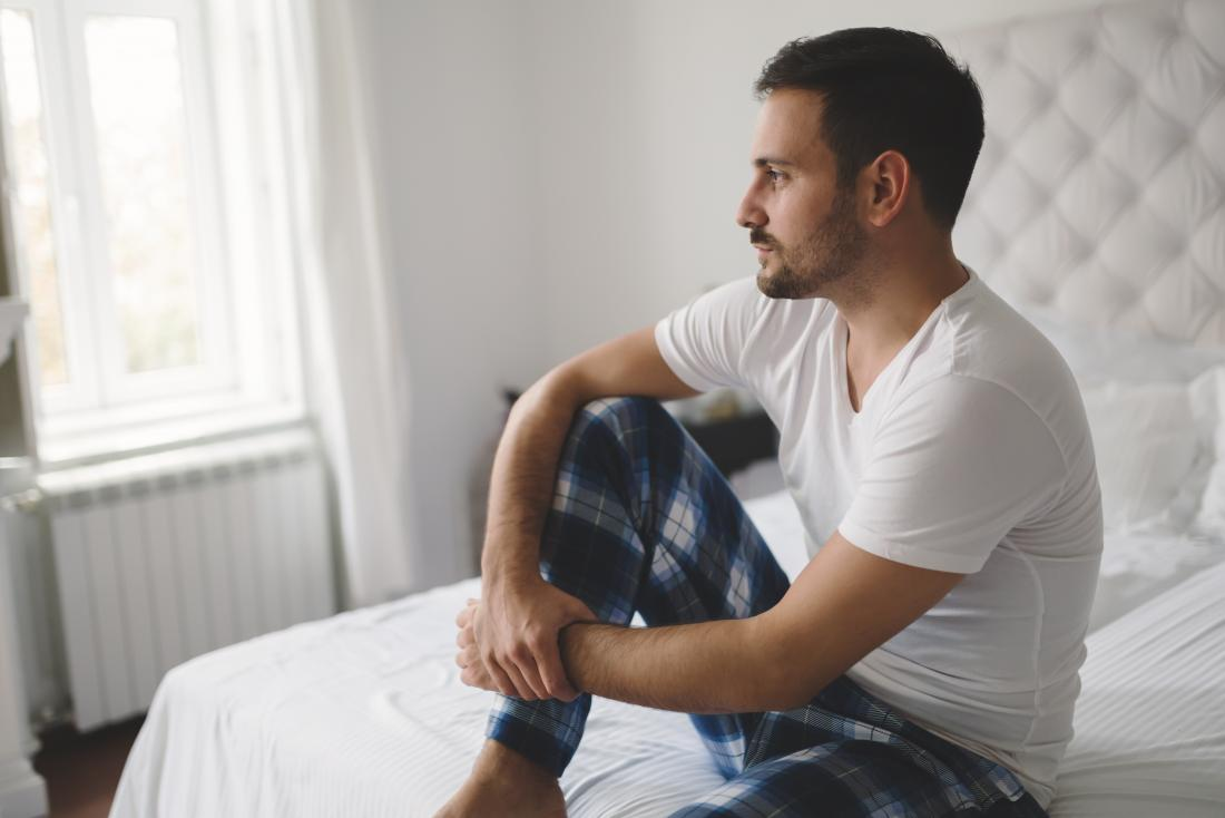 man-sitting-on-a-bed-looking-contemplative-suffering-from-erectile-dysfunction-or-ed.jpg