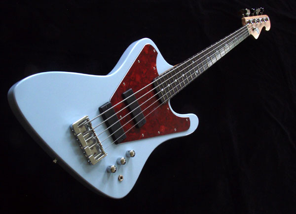 Big Fun - We looked at many pictures of John's bass and also examined an original Thunderbird. We developed a body that looks and feels good, whether you are sitting or standing. The bass is not as top-heavy as you might think!