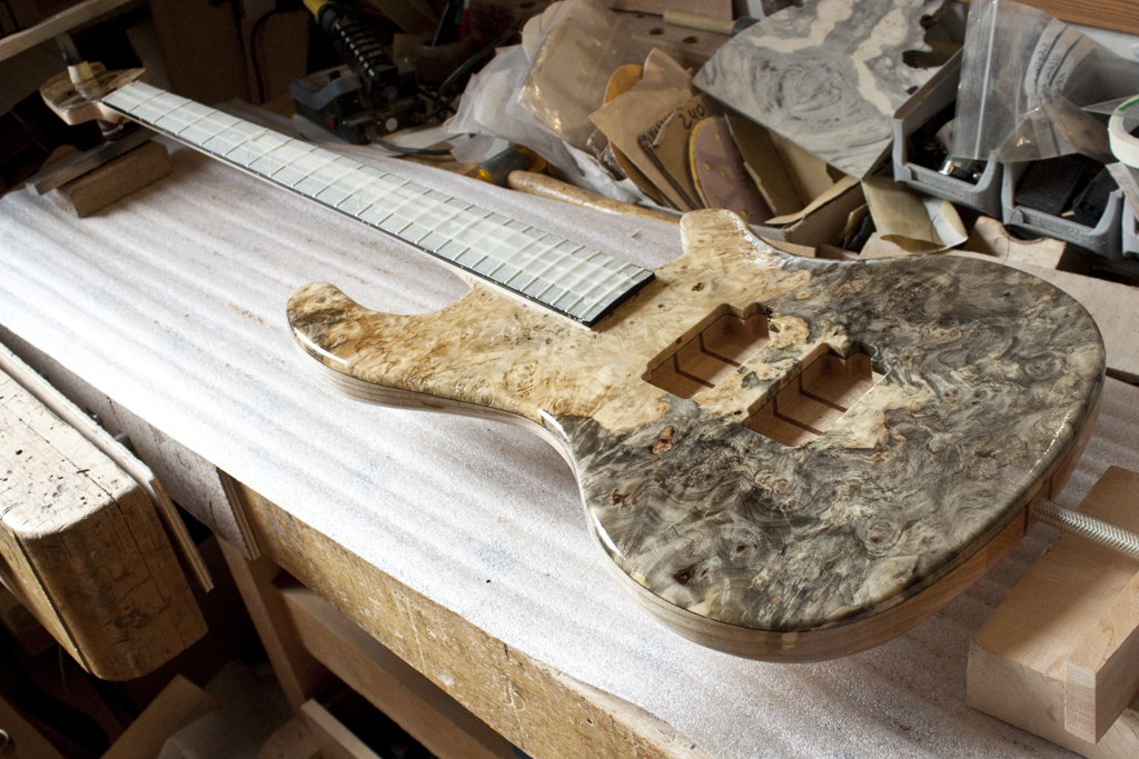 Almost. - Once the paint has dried thoroughly and the frets are inserted, the next step is to mount the pickups and electronics as well as the hardware.