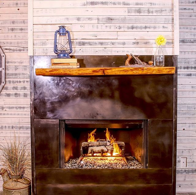 SWIPE to see BEFORE. ➡️ This diy LIVING ROOM MAKEOVER included a complete FIREPLACE 🔥 RENOVATION. I removed the old ugly tiles and weirdly placed mantle and replaced them with blackened steel panels and a walnut live edge mantle I got from my friends @vintagereclaimedlumber. This has completely transformed my living space. The build video is live on Jonny Builds YouTube channel.  #livingroomdecor #fireplace #homemakeover