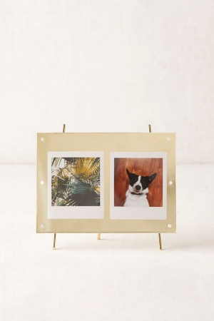 A Friendly Face - A friendly face never hurt anybody. If you're having a bad day, you can stare at an adorable photo of friends, family, your pet or significant other to cheer you up. Check out Urban Outfitter's easel-inspired frame for ultimate cuteness.