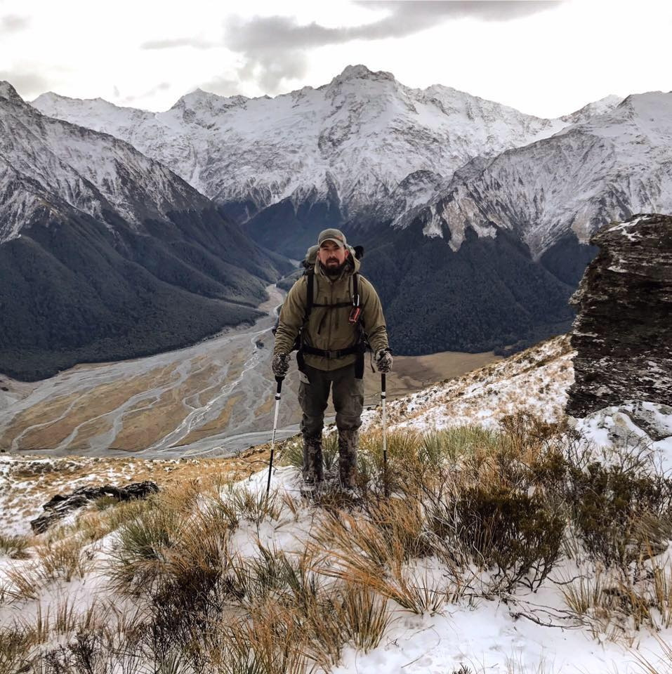 Ben_Obrien_MeatEater_hiking_on_a_mountain_top