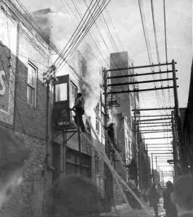 In 1955, one of the apartments behind the shop went up in flames.