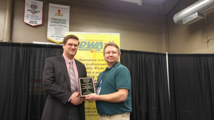 Josh Mickelborough being given the Professional Manager of the Year Award by Dale Petrun, an SPWA board member