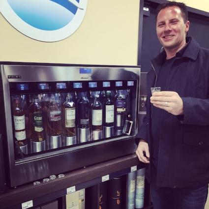 Dan Stadnyk testing out the Enomatic Scotch dispenser
