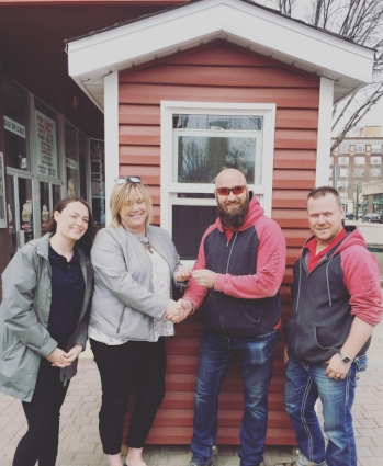 Kaitlyn Aparicio and Jacki L'Heureux-Mason with Wendell Gillert and Nick Pettigrew, from Home Building Centre (who donated the building)