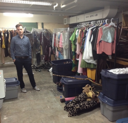 Derek Cronan standing beside some of the shared space and all of the things stored