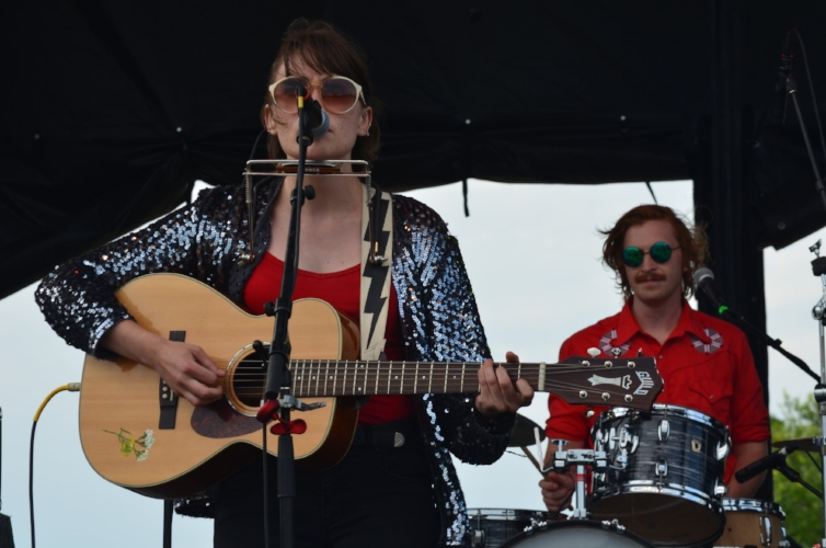 Small town folkster Ellen Froese alongside her drummer in cool psychedelic shades. Ellen was born in a Mennonite homestead and homeschooled. Somebody there must have had some pretty great musical chops.