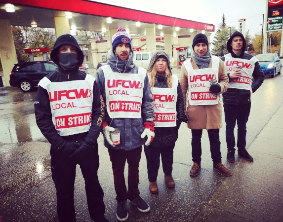 Picketers in front of the Co-op gas bar located on 9th Avenue on South Hill.