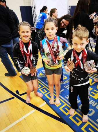 From Left to Right: Kenzie Woods, Chloe Beliveau and Zack Wilgosh showing off their medals