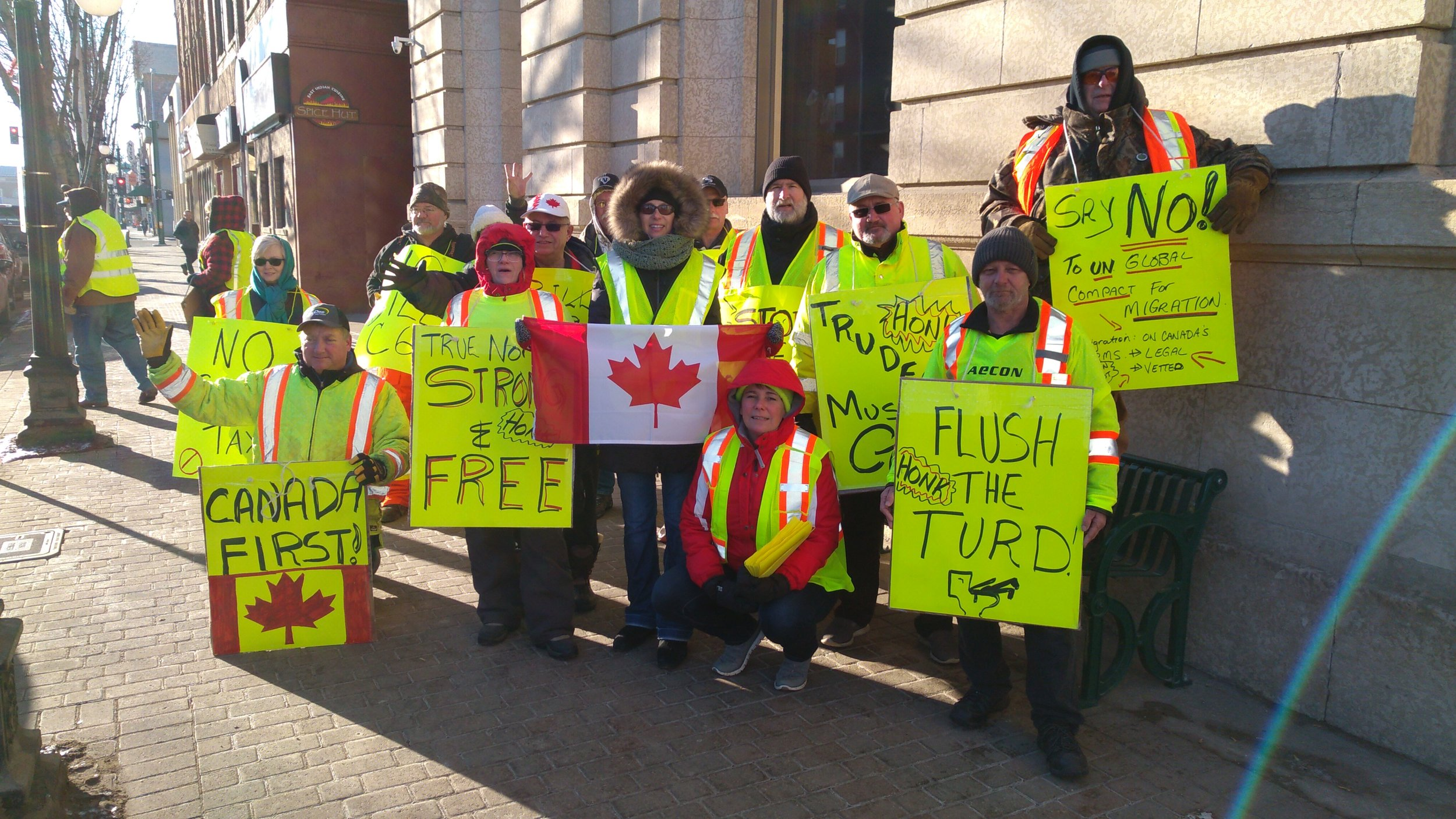Group photo of some of the protesters today in front of City hall.