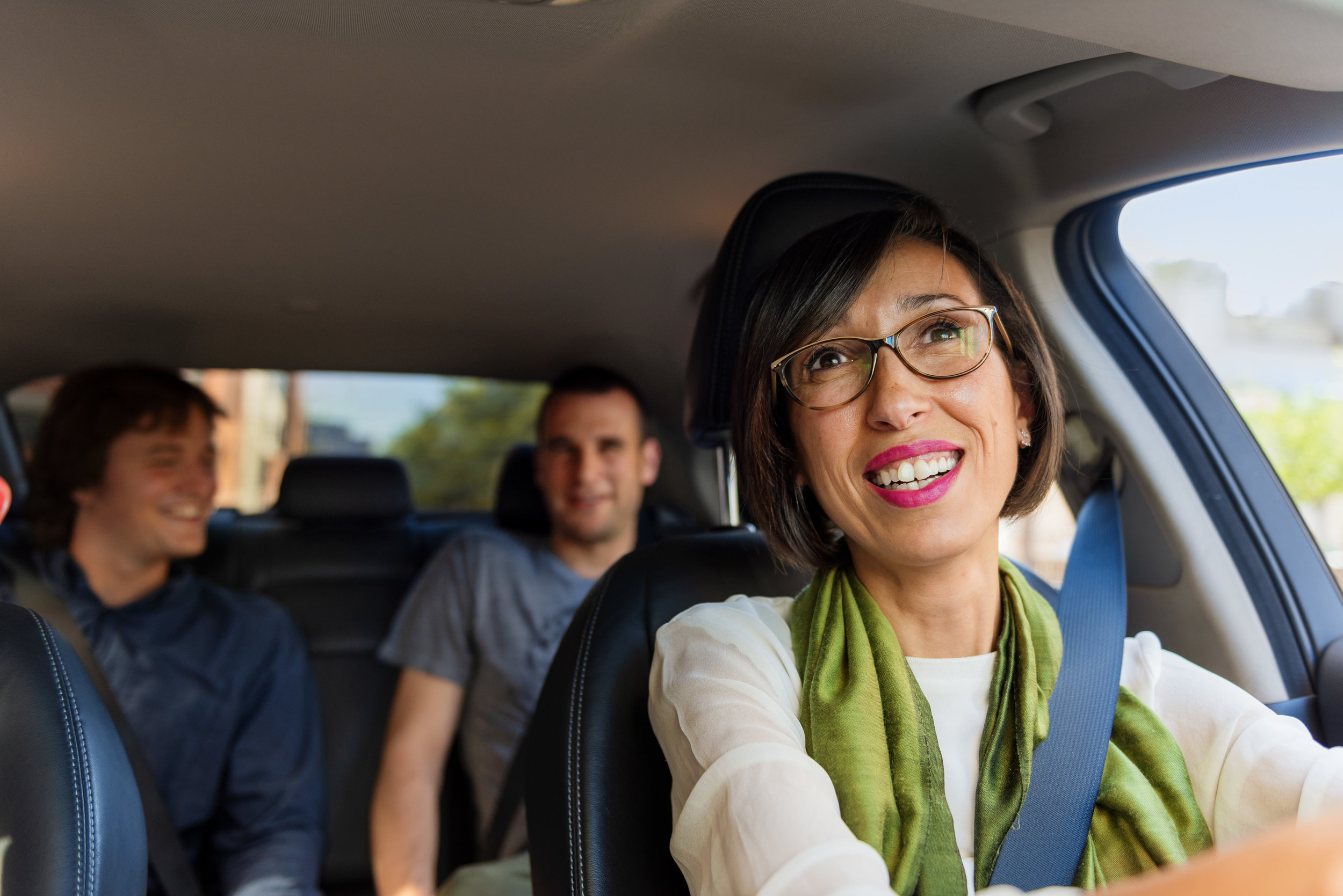 An Uber driver with passengers - Photo Compliments Uber Canada