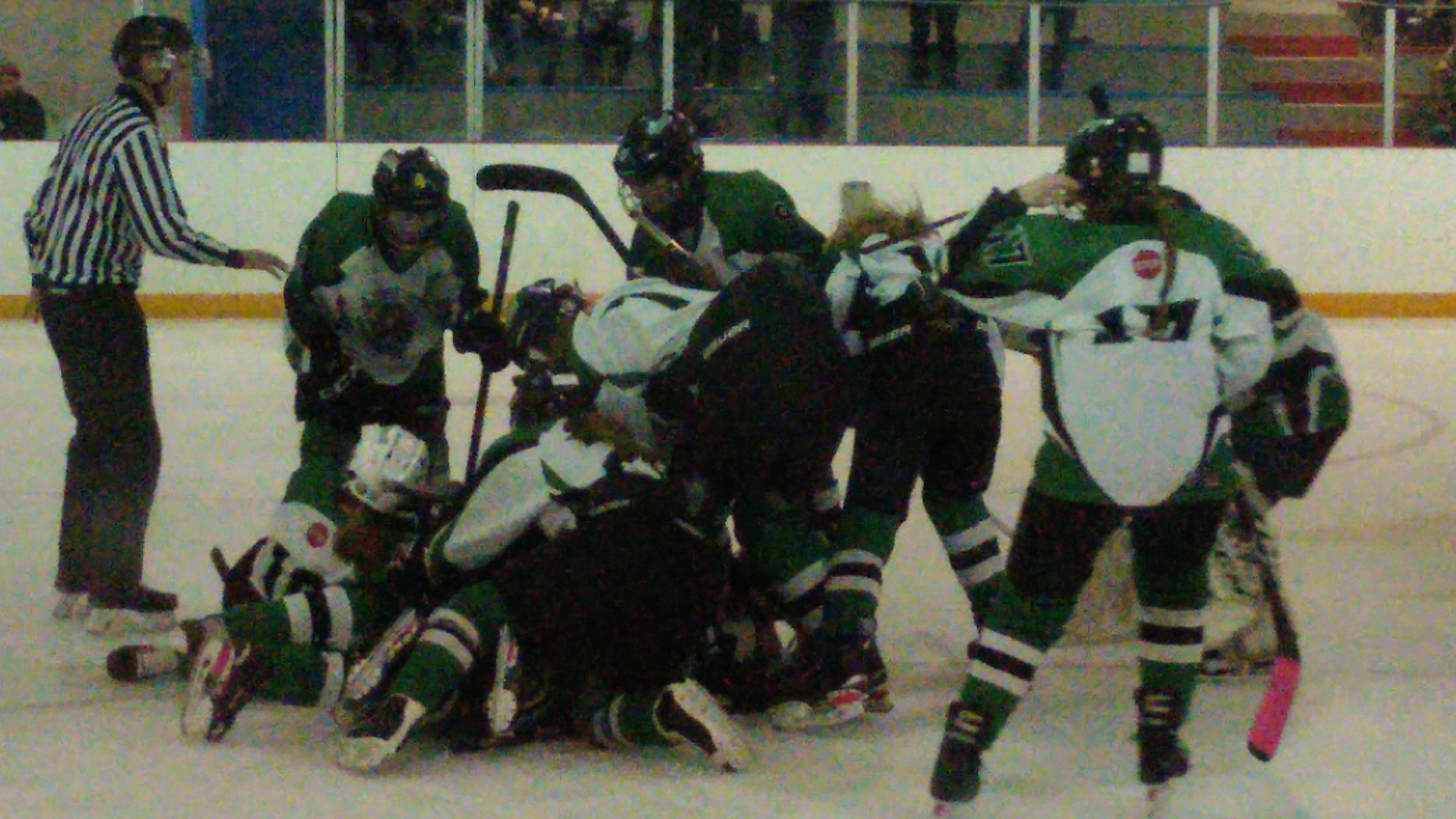 The Mavericks pile on in celebration after scoring the overtime winner