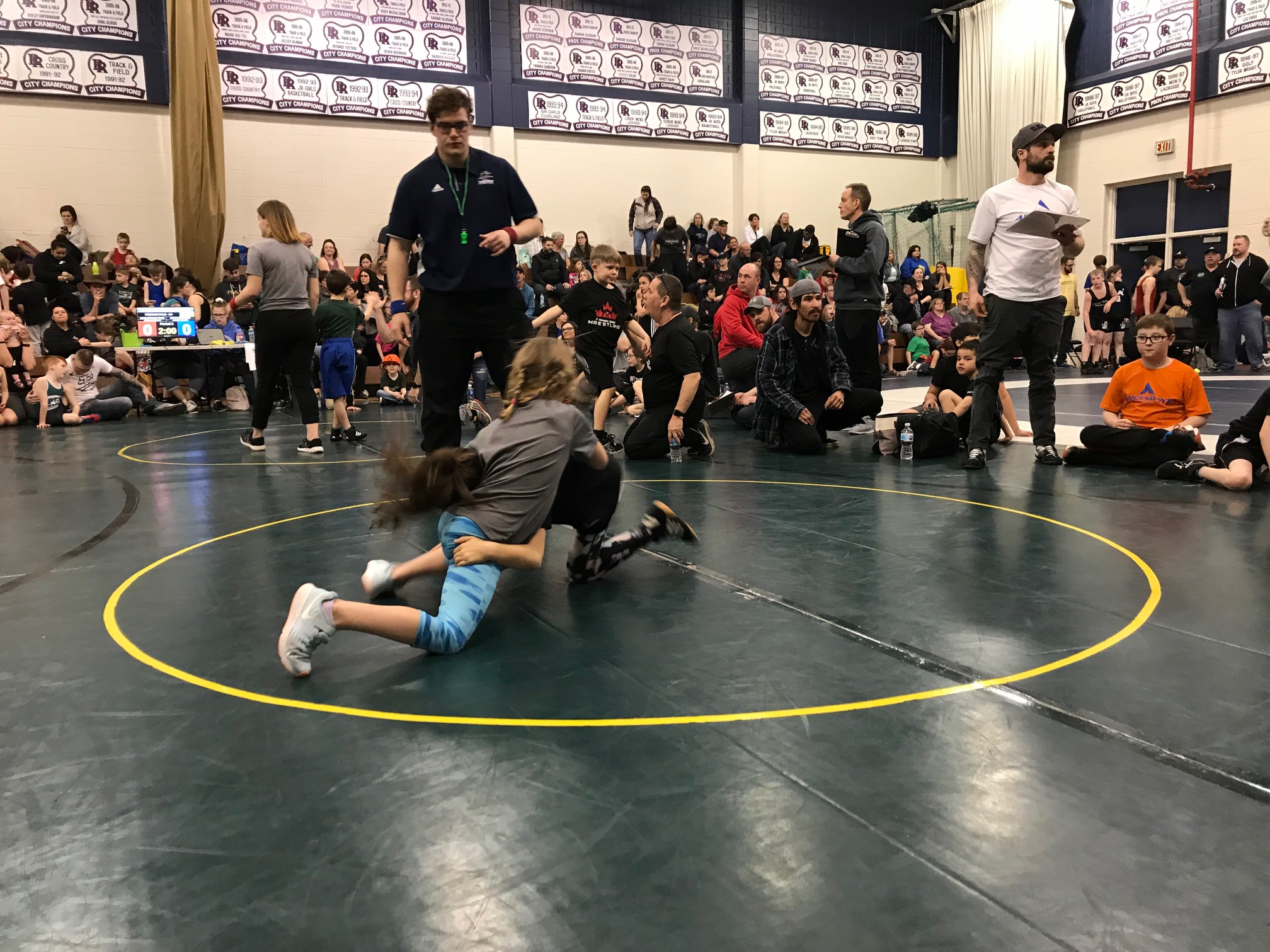 Rose Alexander (in the grey shirt) Grapples During a Hard Fought Match