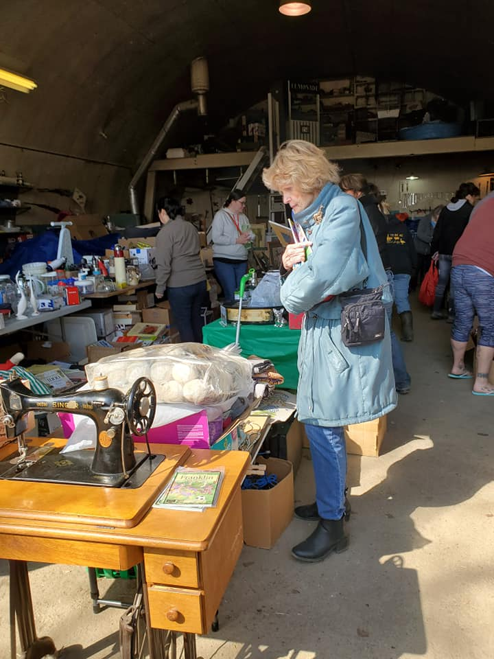 The quonset was full, already partly emptied out by this time. Thanks to all the donators. (Photo by K. Epp)