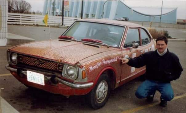 Ernie Penney with the original Pennymobile and the Moose Jaw Civic Center in the background