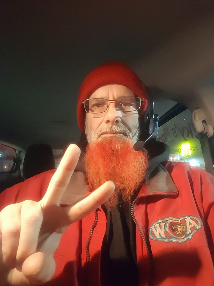 Tim with his trademark red beard and peace sign