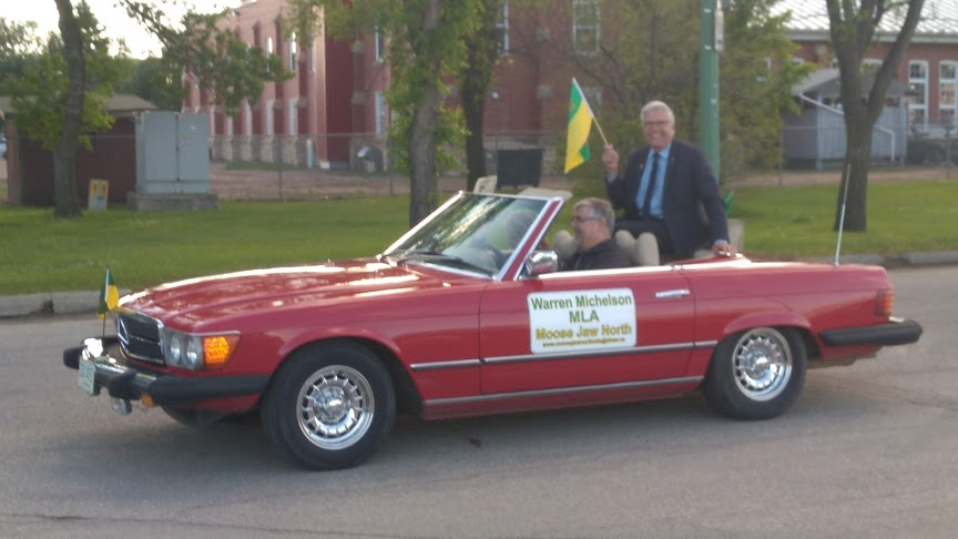 Warren Michelson, MLA for Moose Jaw North, rode in the back seat of a red convertible