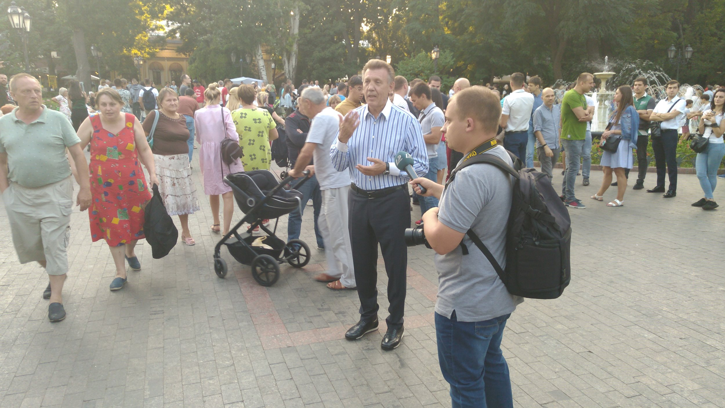 Kovalov gives his later to be broadcast public interview using the festivities behind him as a backdrop
