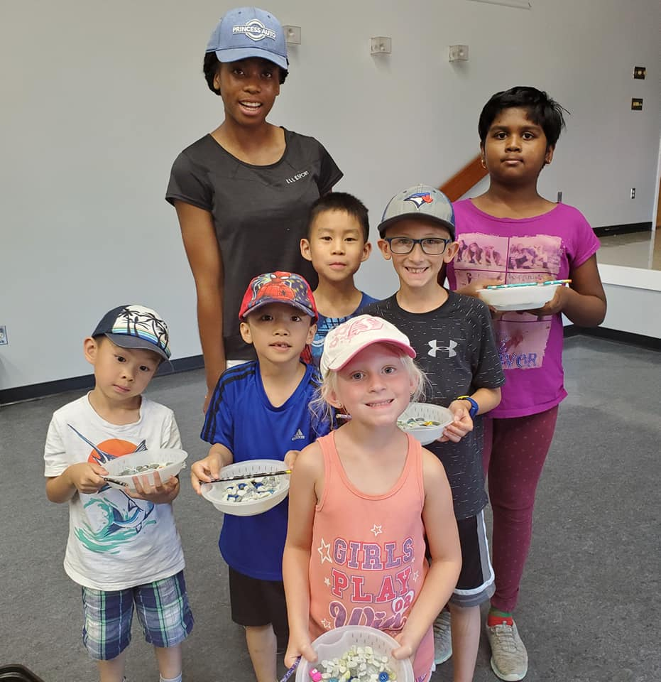 Kids from the day camp showing off their completed bee baths - Photo by K Epp