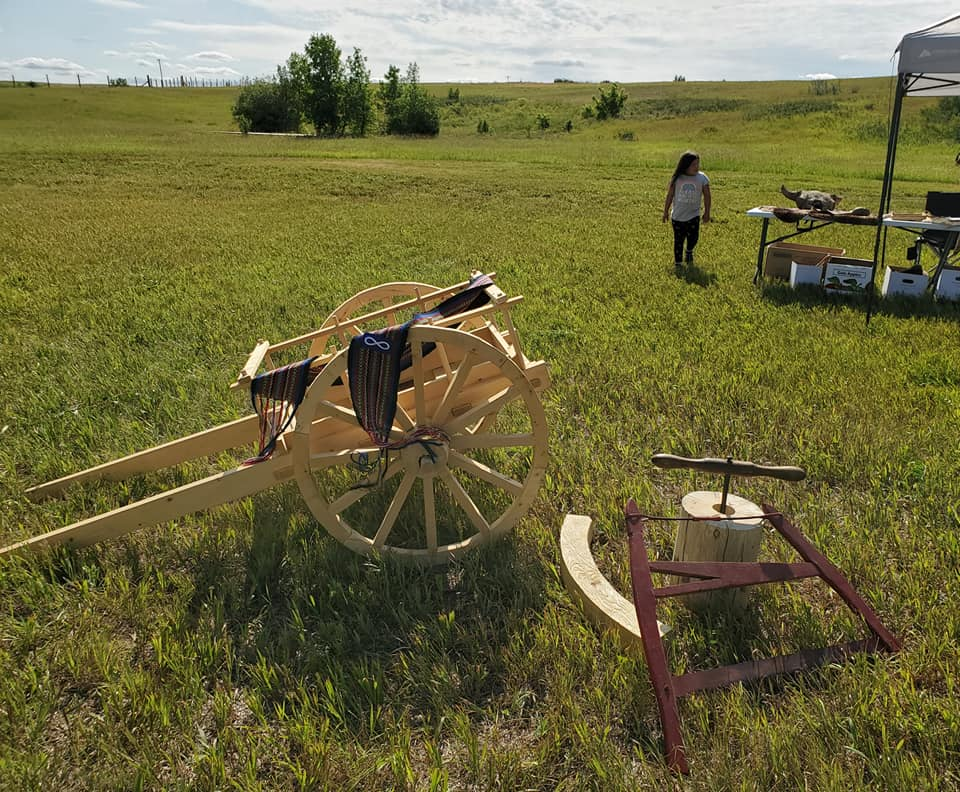 Some pioneer items and cart - Photo by Kimberly Epp