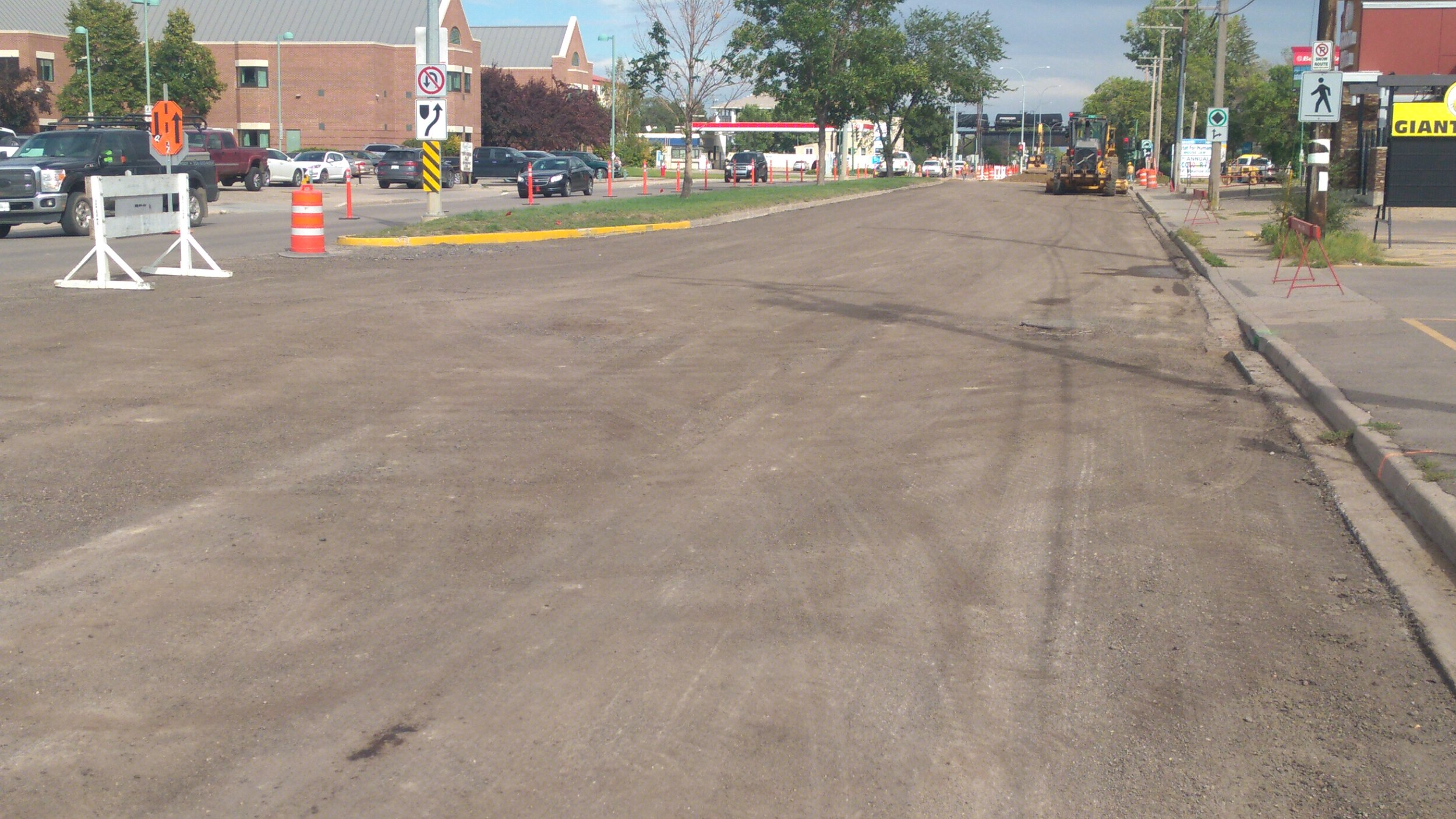 The south lane of Manitoba Street East from Main St to Second Ave NE remains closed