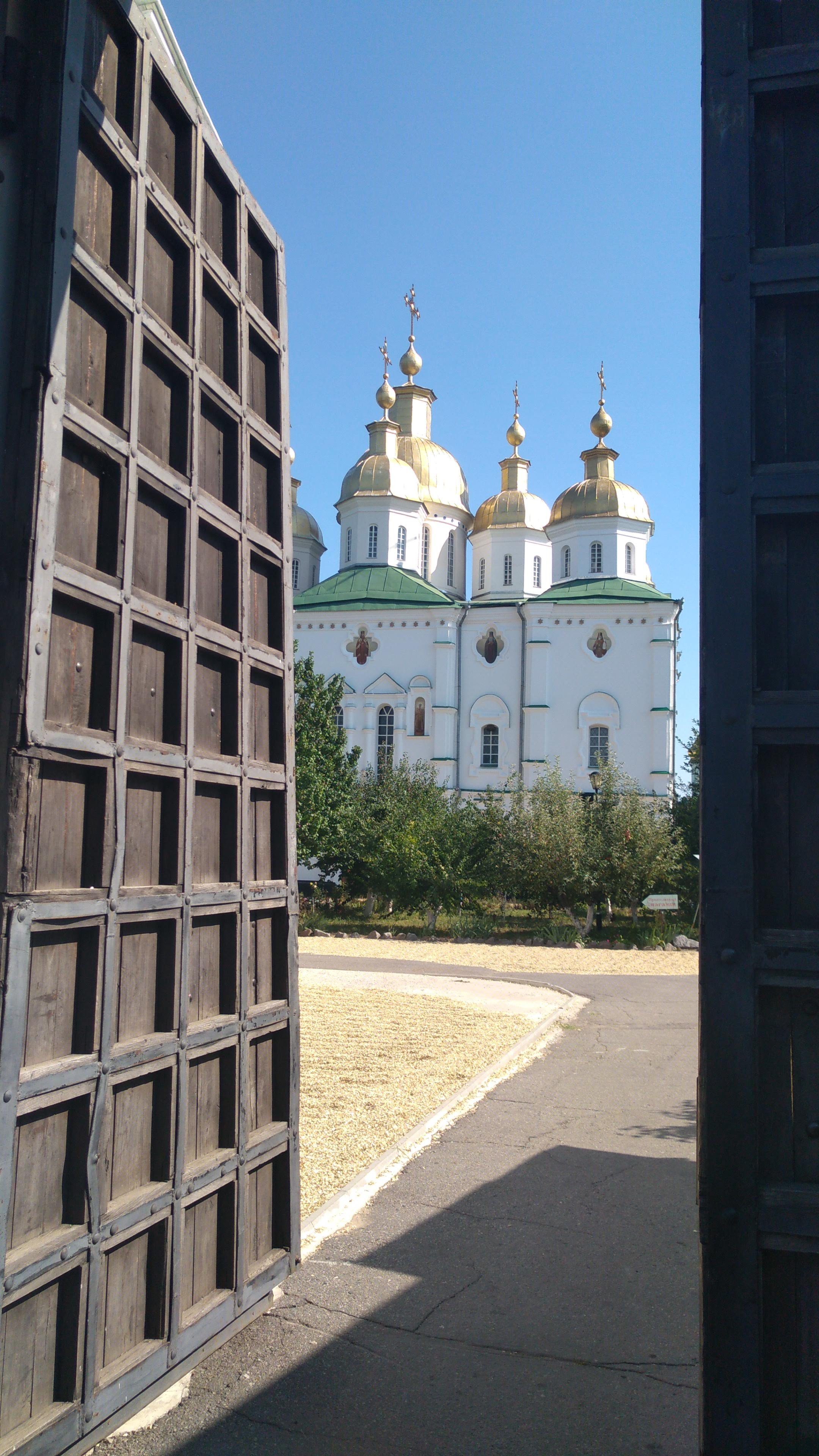 Entry gate to the Holy Cross Monastery showing the cathedral