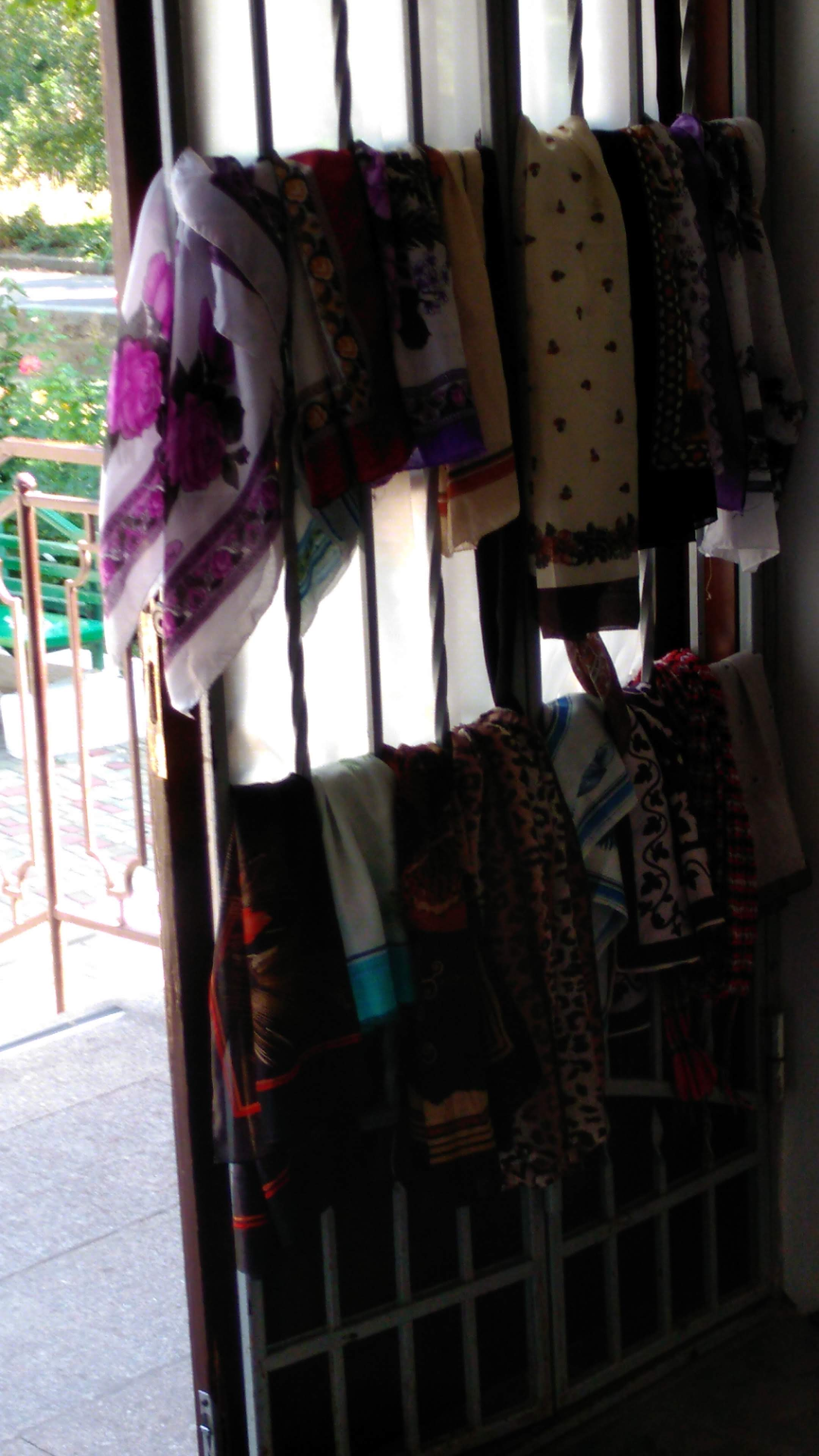 Scarves hang at the entry way which may be worried