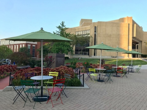 Bistro tables and umbrellas at University of Akron, made possible by Knight Foundation.