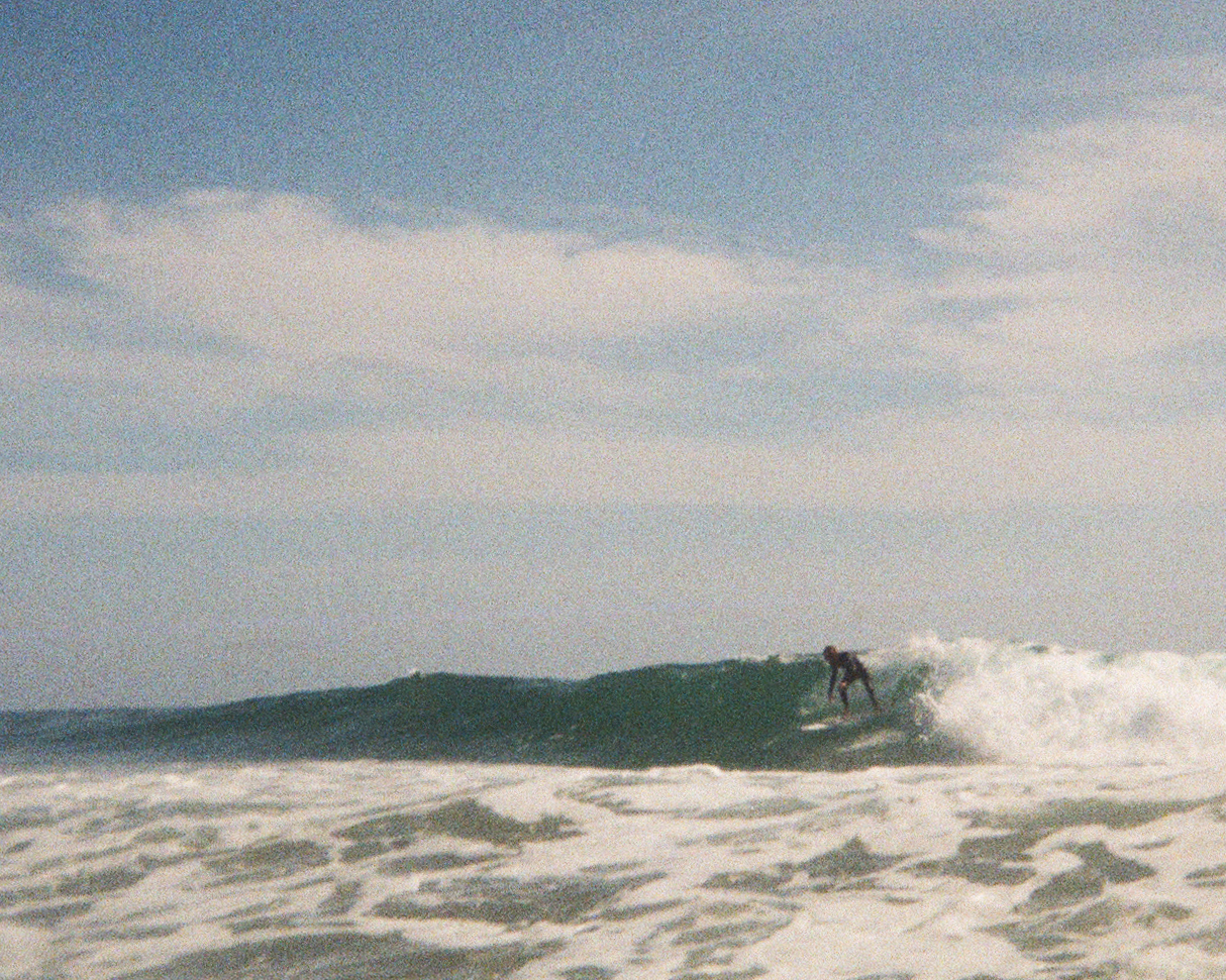 Photograph of Jon Moore surfing in Baja Mexico, Creative Director at The Beans and Rice