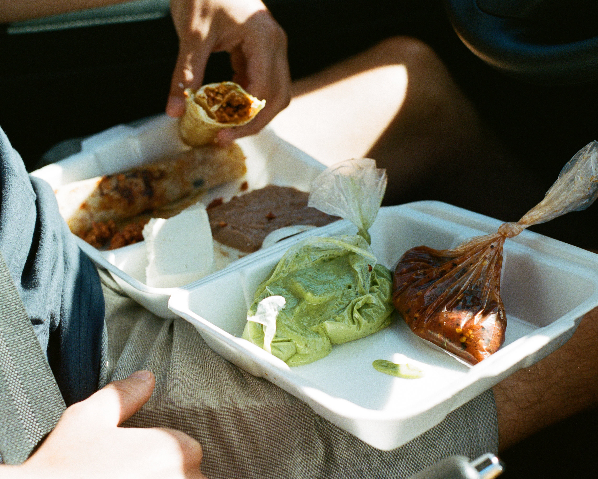 Photograph of Nick Messina eating street tacos in Baja Mexico by photographer Jon Moore, Creative Director at The Beans and Rice