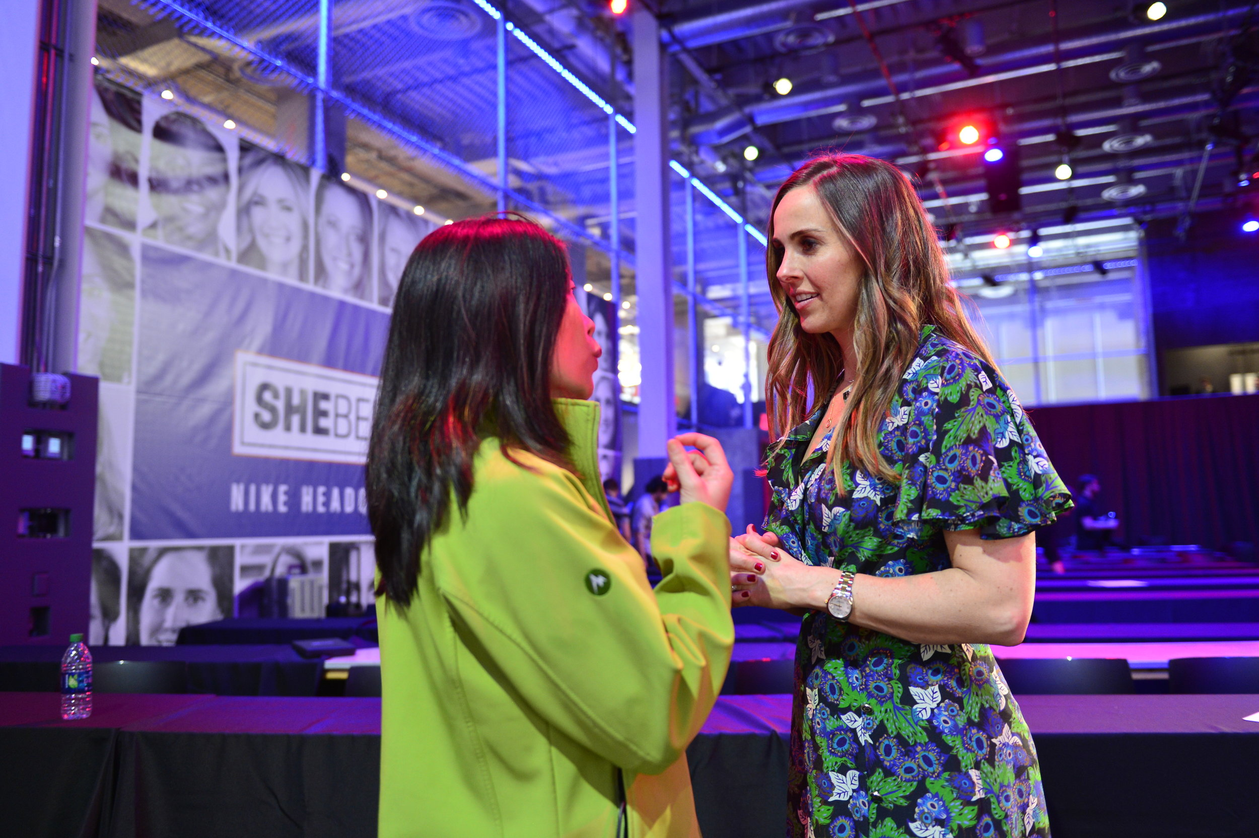 Heather Mitts speaks with a SheBelieves Summit attendee.