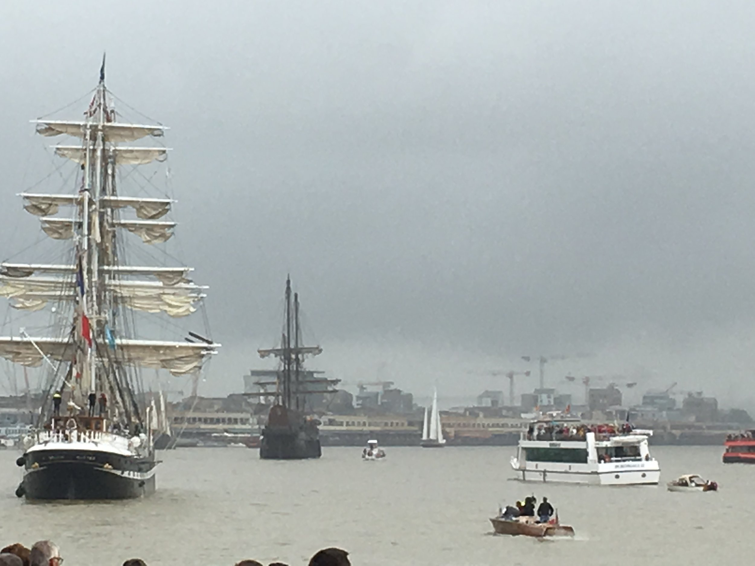 The masted ships leaving quai in Bordeaux marking the end of the wine festival
