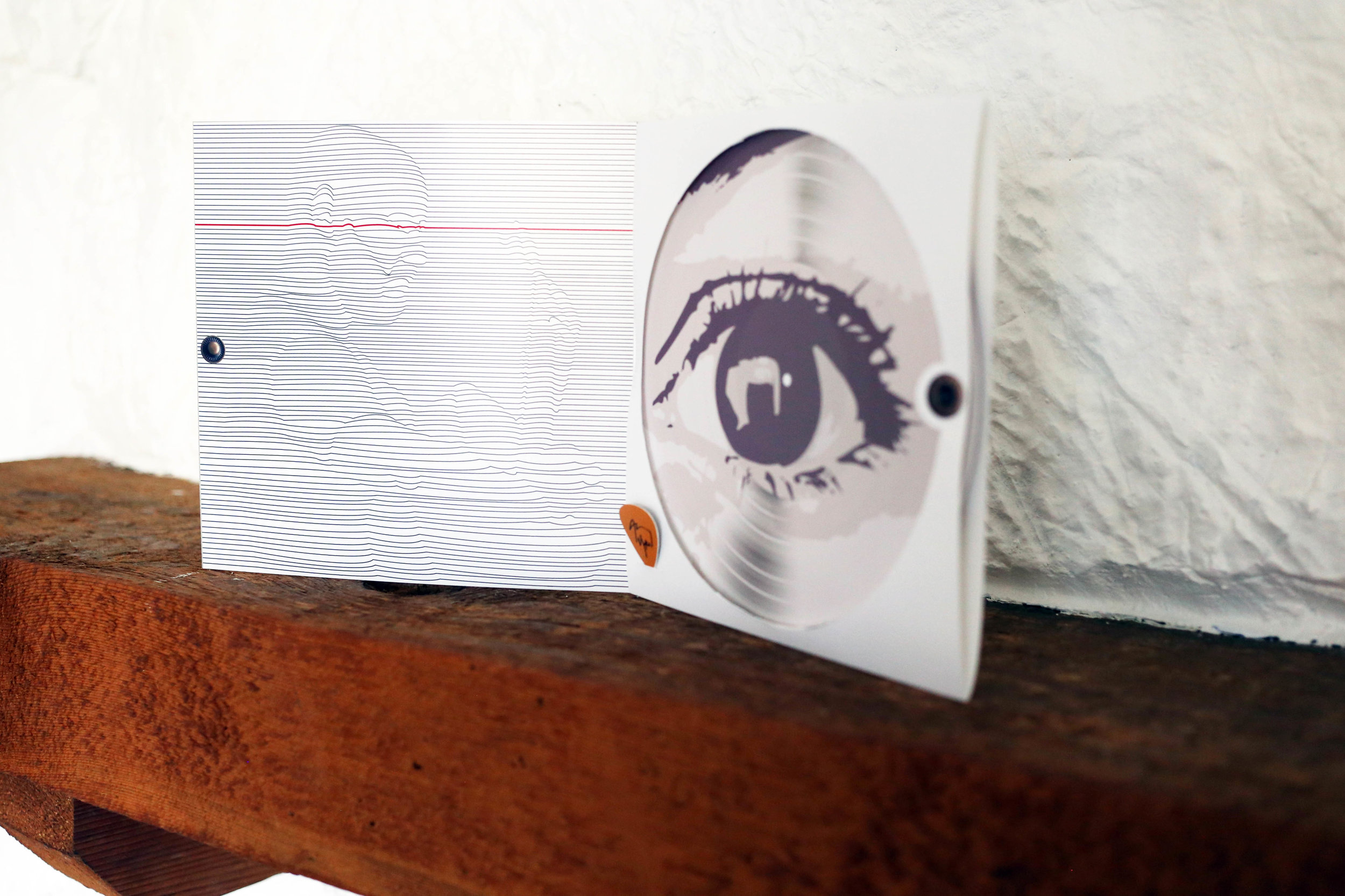 Contrasting expressive eyes are shown on each side of the vinyl record,as Andy's instrumentals can be interpreted differently from listener to listener. Additionally, a portrait of Andy is shown on the inside, drawn through lines, illustrating the feel of vibrating guitar strings.
