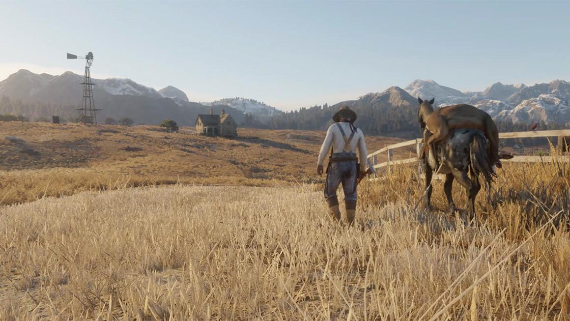 """De gyldne kornmarker og sneklædte bjergtoppe i horisonten er med til at skabe et billede af idyllisk liv ved den amerikanske """"frontier"""" i Red Dead Redemption 2."""