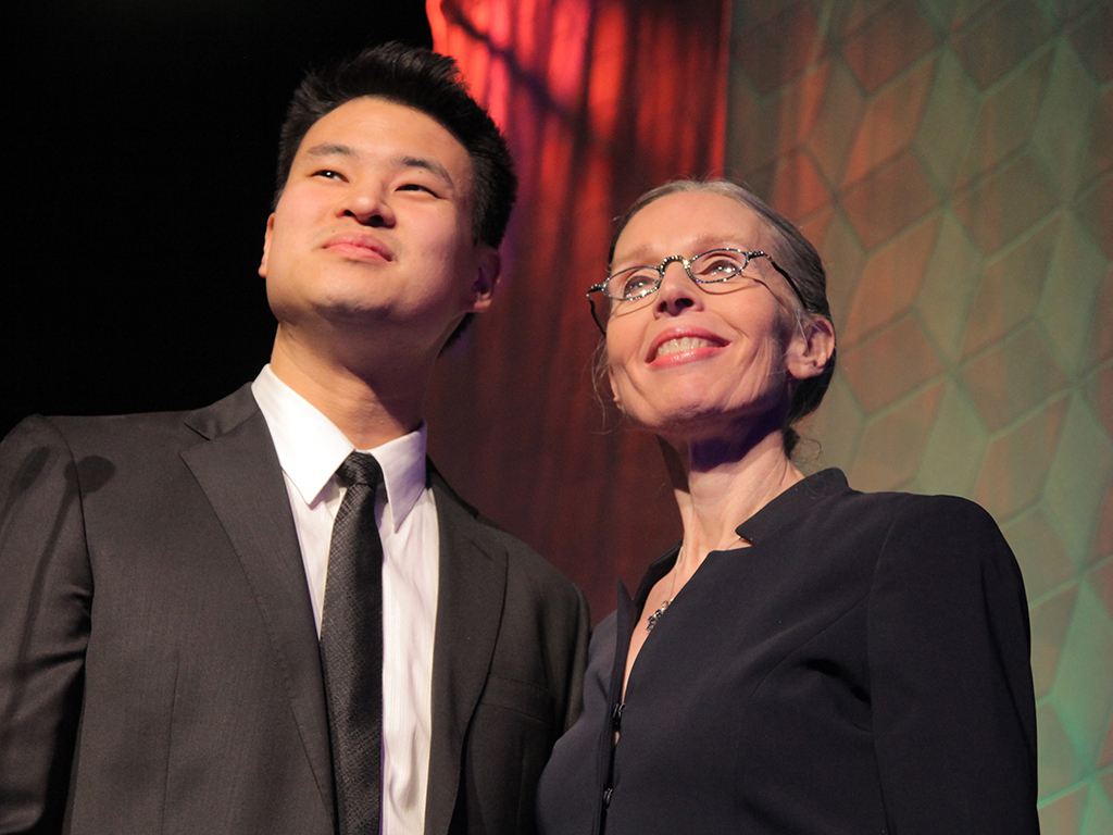 Carey and her son-in-law, Adam She, on stage