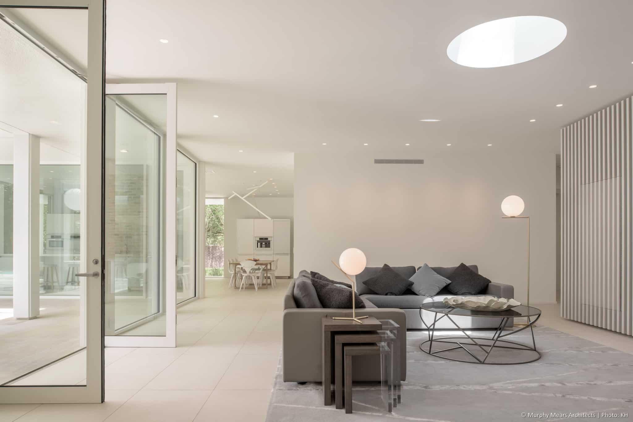 w-mid-century-modern-home-hugo-neuhaus-renovation-living-room-skylight-fin-wall2.jpg