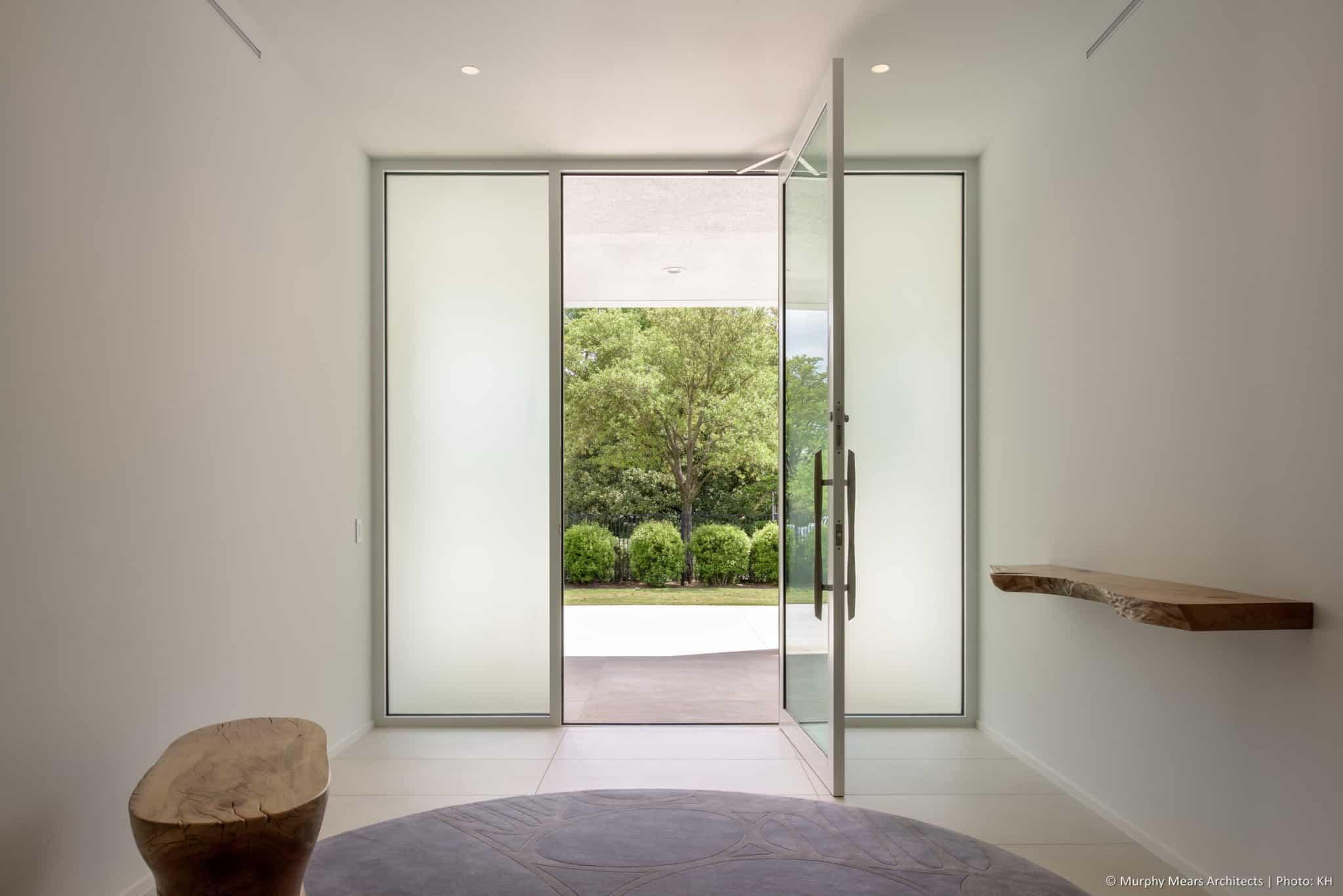 w-mid-century-modern-home-neuhaus-harwood-taylor-renovation-alumnium-storefront-entry-door.jpg