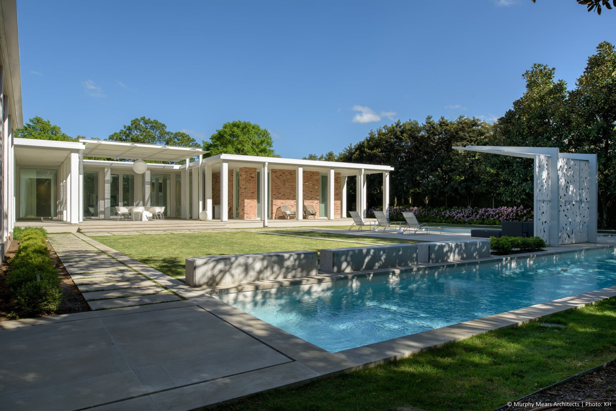 w-mid-century-modern-home-neuhaus-harwood-taylor-renovation-back-yard-trellis-lap-pool.jpg
