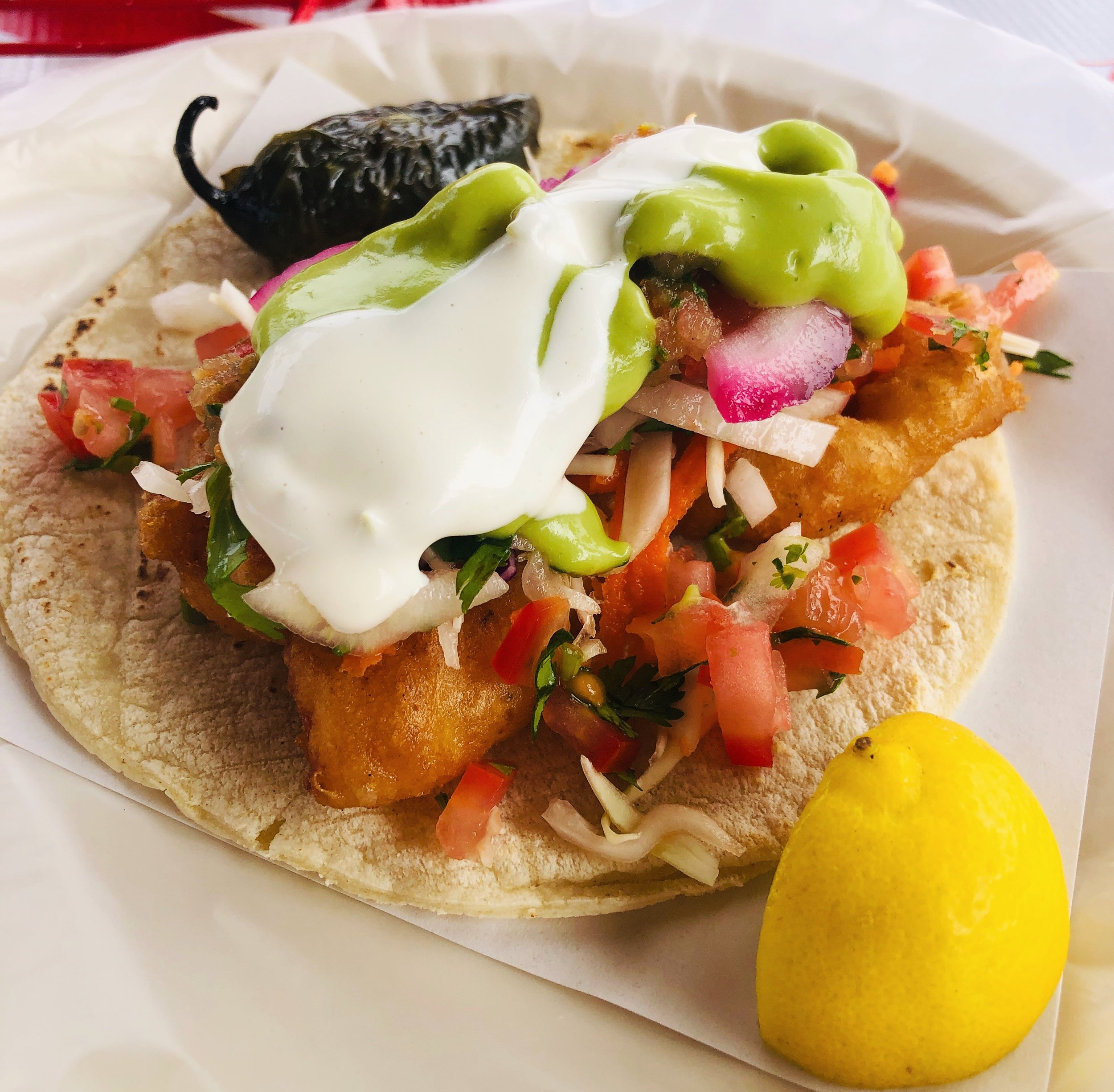Option 1: Fish Tacos! - Fresh Squeezed Palomas, Roasted Habanero Salsa, Avocado Crema, Hand Made Corn Tortillas, Fried Shrimp, Blistered & Marinated Serrano Peppers and Pickled Onions.