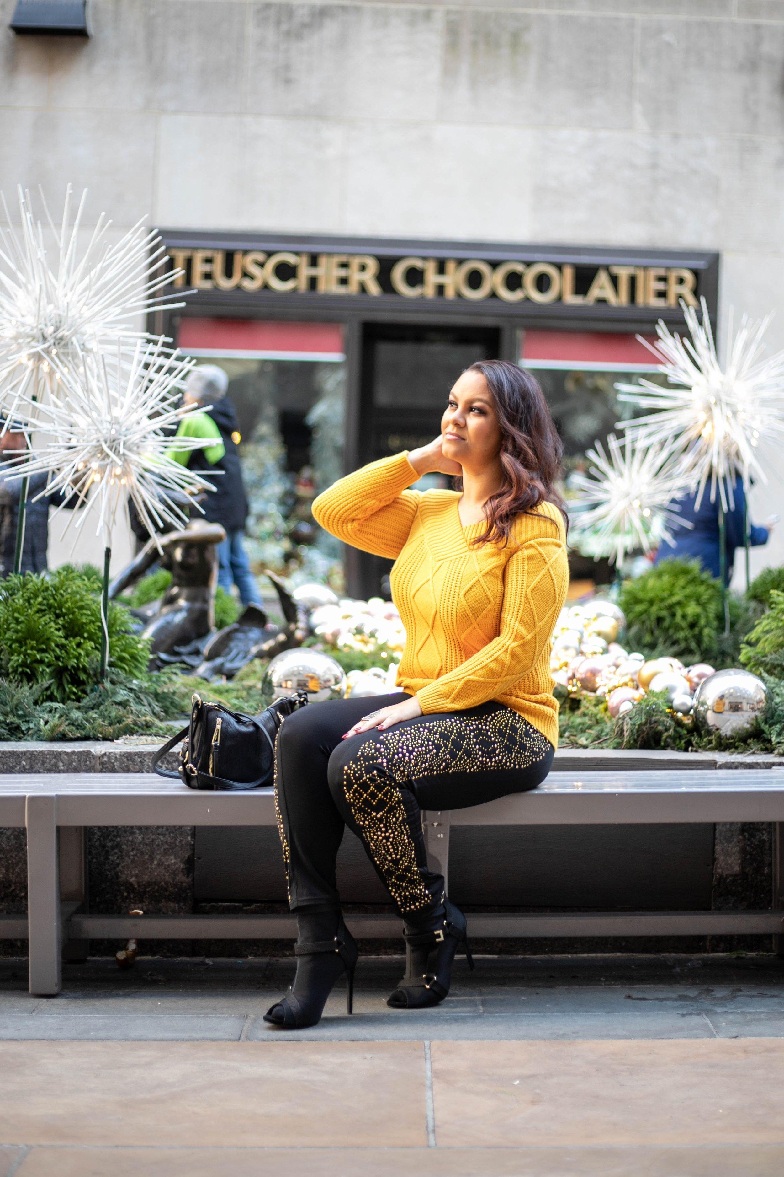 "Outfit Deets - Gold Off-The-Shoulder Sweater: VenusBlack & Gold Studded Leggings: VenusBlack Heels ""Tempted"" in Black: Miss LolaCrossbody Bag: Jessica Simpson"