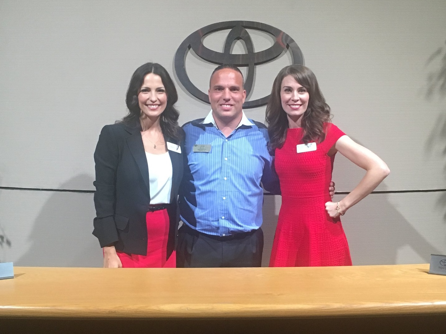 Pictured above is Louis Rylant with Jan and Mariela, Toyota USA spokeswomen at a dealer event.