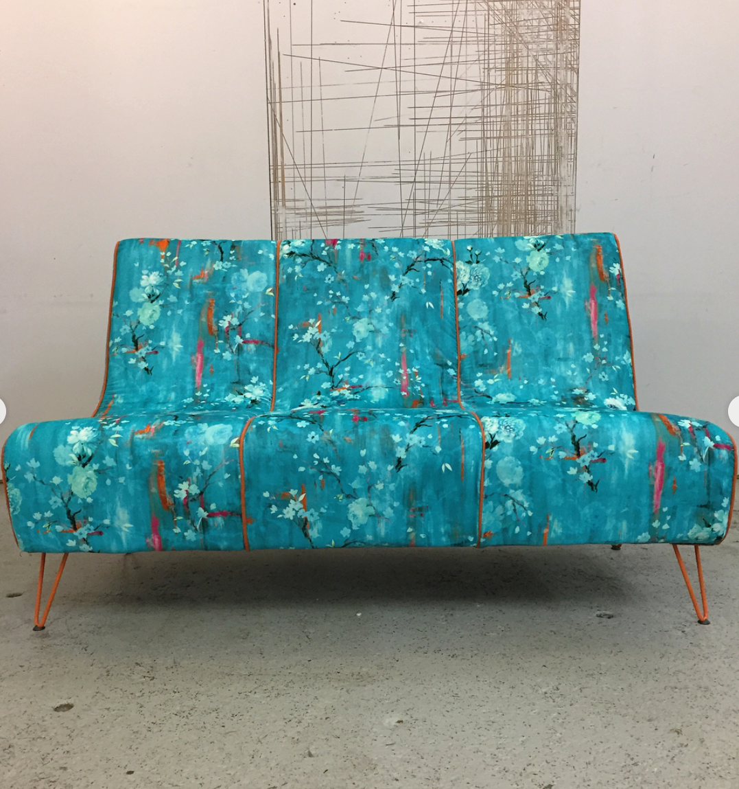 1970s sofa restored by Leigh-Anne Treadwell from The Bristol Upholstery Collective, using cotton velvet from Salon Libertine London in 'Perfumes of the Night Floral Edition', in 'Matisse Green'.