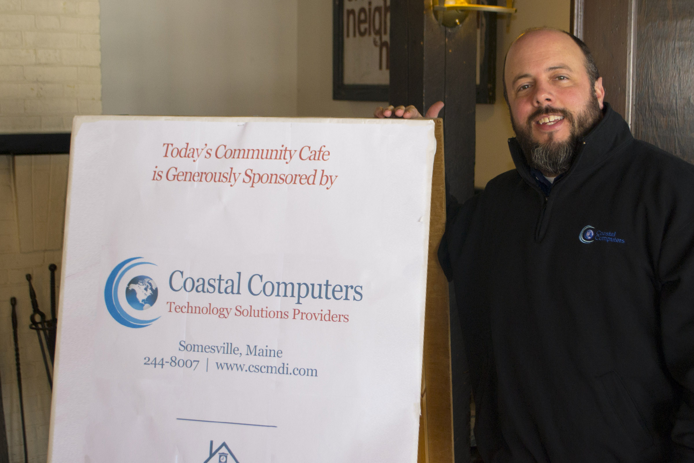 George Grohs, owner of Coastal Computers, also serves as a volunteer on The Neighborhood House's Board of Directors.