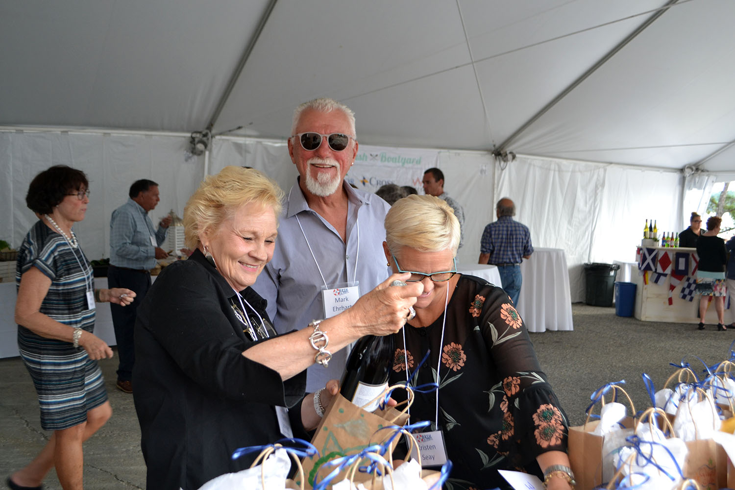 "All smiles at the ""Wine Grab""— a fun new addition to the event!"