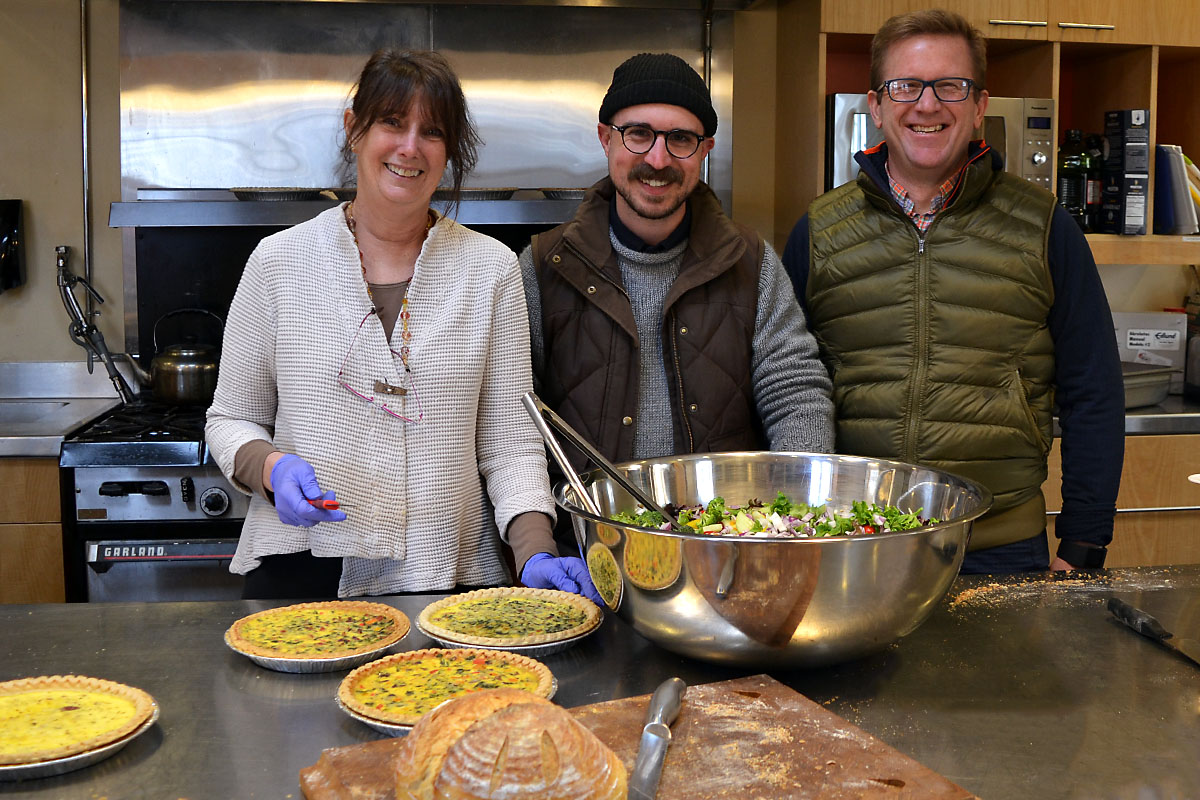 MD365 Executive Director Kathy Miller, Communications Manager Alex Birdsall, and Board member Rodney Eason helped with kitchen prep in anticipation of the large crowd of about 140.