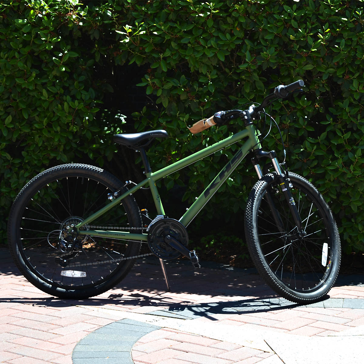 "Youth Size mountain Bike - This KHS T-Rex youth size mountain bike from Island Bike Rental has everything a young rider needs to zoom across town or explore the carriage roads. Featuring a 24"" front suspension and high quality Shimano components, this stylish bike also includes a Bell helmet."