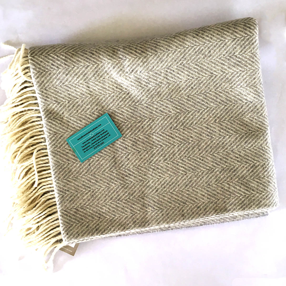 Irish Wool Blanket - This beautifully crafted Irish wool blanket was generously contributed by Sweet Soles Boutique on Sea Street in NEH. While it works as a great accessory to almost any piece of furniture in the house, it's so soft you'll have a hard time not wrapping yourself up every time there's a chill in the air.Retail Value: $200.00